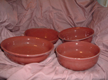 thrown bowls in red glaze